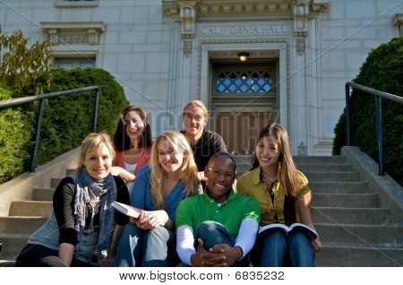 Diverse college students on campus stairs