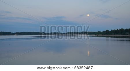 Moon shining over river