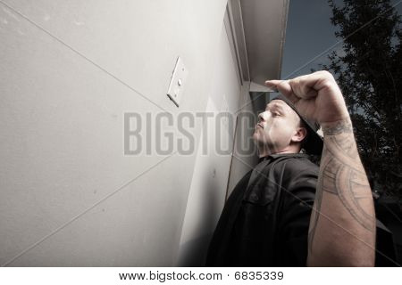Man ringing the doorbell