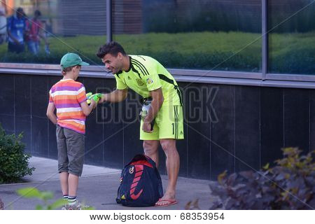 MOSCOW, RUSSIA - JULY 13, 2014: Goalkeeper of team Spain F. J. Donaire aka Dona gives his gloves to the boy after Moscow stage of Euro Beach Soccer League. Dona became the best goalkeeper of the stage