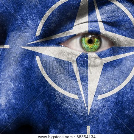 Flag Painted On Face With Green Eye To Show Nato Support