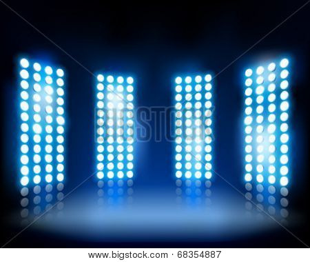 Floodlights on the stage. Vector illustration.