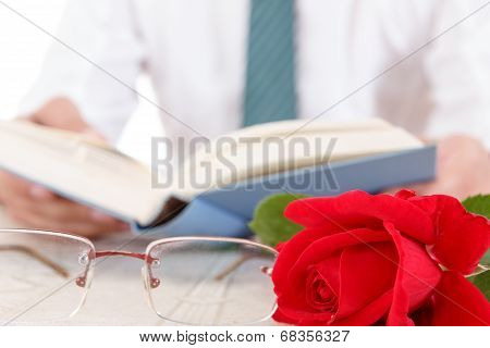 Man In Shirt And Tie With His Hands Holding Open Book And Leafing Through Pages