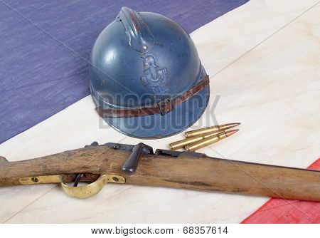 French Helmet Of The First World War With A Gun On A Blue White Red Flag