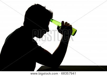 Silhouette Of Alcoholic Drunk Man Drinking Beer Bottle Feeling Depressed Falling Into Addiction Prob