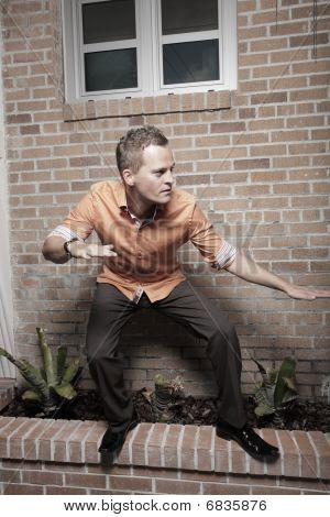 Man balancing on a ledge