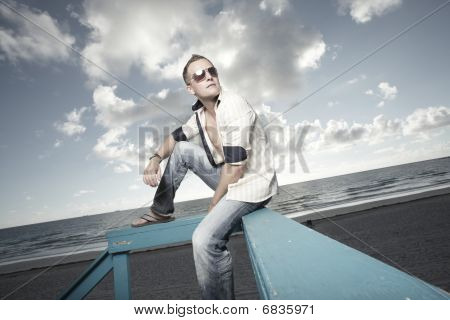 Man on a lifeguard hut