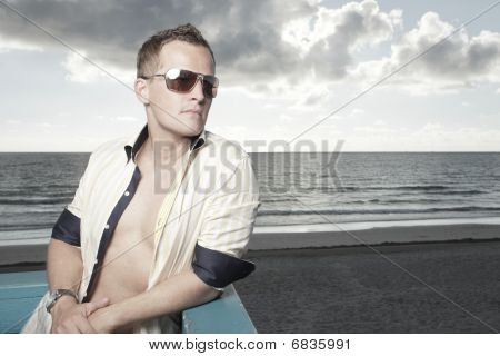 Man posing on a lifeguard stand