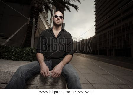 Man sitting in the city