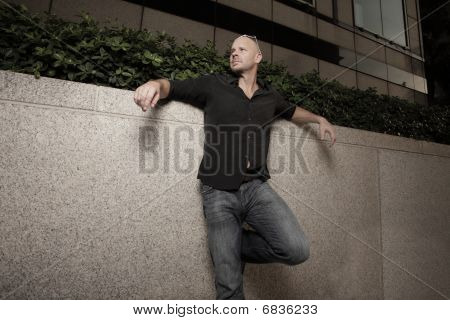 Man posing in the city at night