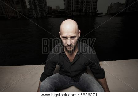 Image of a man with a shaved head