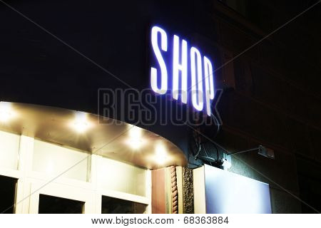 Neon sign on store at night