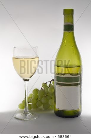 Wine Grapes And Bottle