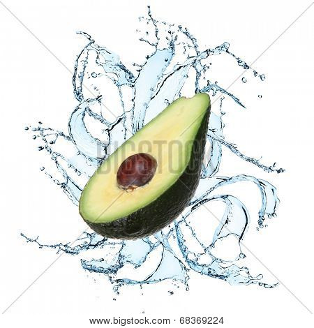 Fresh avocado with water splash over white background