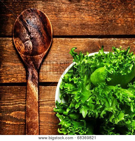Beautiful Fresh Salad In A Dish With Wood Spoon Over Vintage Wooden Table, Top View, Close Up.