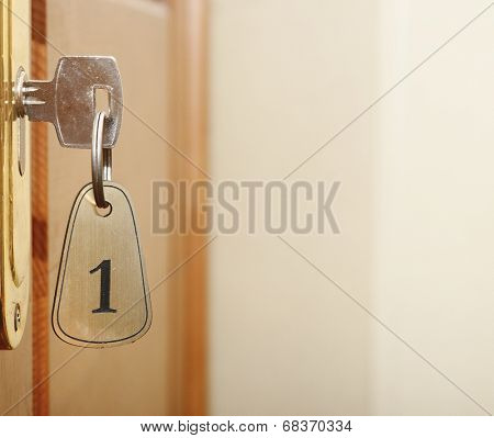 key in keyhole with numbered label