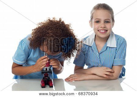 Two School Kids Doing Research