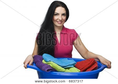 Woman Holding  Laundry Basket With Towels