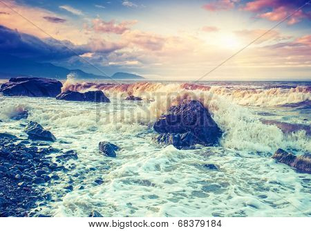 Amazing morning sun over the sea with overcast sky. Black Sea, Crimea, Ukraine, Europe. Beauty world. Retro style filter. Instagram toning effect.