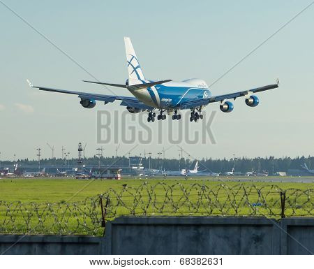 Calling of a cargo airliner on landing at the airport in the evening