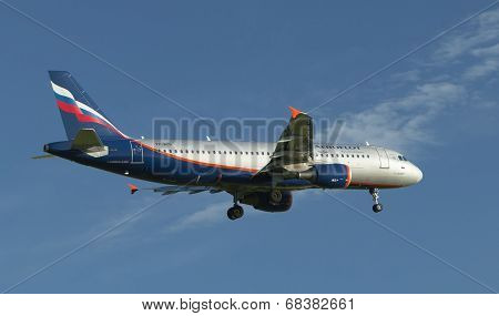 Airliner calling on landing at the airport in the evening