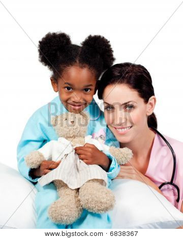 Cute Little Girl With Her Doctor Smiling At The Camera