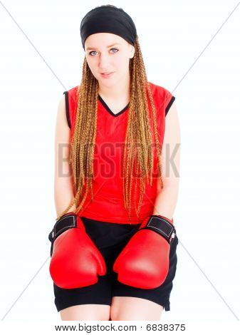Young Woman Sitting With Boxing Gloves Over White
