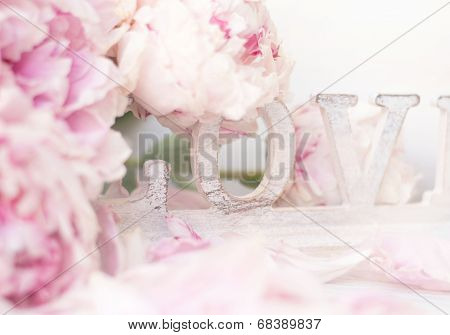 Peony flowers and wooden word Love