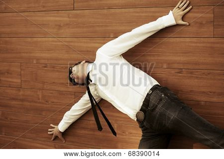 Young business man in despair lying on the floor