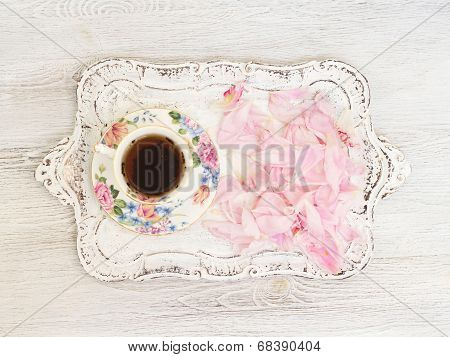 Tea cup with peony petals - shabby chic background