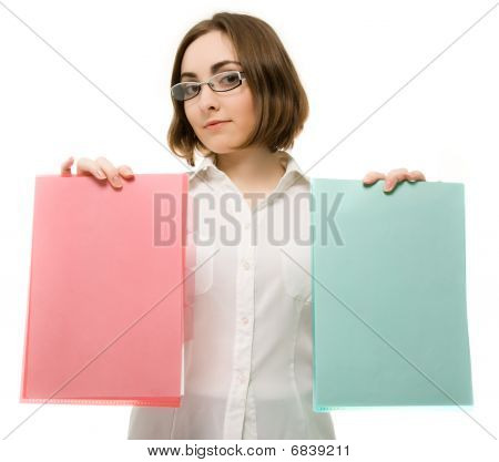 Picture Of A Girl In White Holding Two Folders