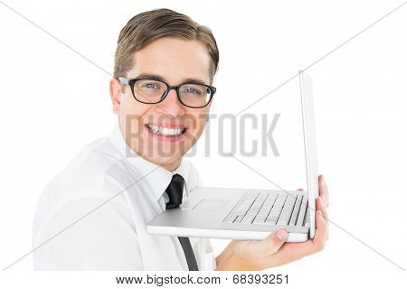 Geeky businessman holding his laptop on white background