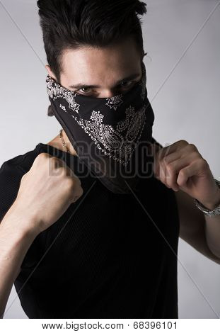Man In A Bandanna Balling His Fists Aggressively