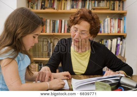 Senior Helping Child Doing Homework