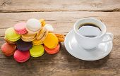stock photo of french pastry  - French colorful macarons with cup of coffee - JPG