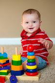stock photo of playgroup  - Baby boy playing with stacking learning toy - JPG
