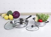 image of stew pot  - Set of stainless pot and pan with glass lids and vegetables - JPG