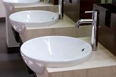 picture of wash-basin  - Three of wash basins in the rest room - JPG