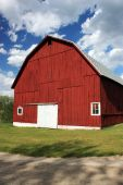 stock photo of red barn  - Side of the a red barn in Michigan - JPG