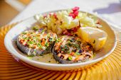 foto of swordfish  - close-up two grilled swordfish steaks with lemon slice and cabbage