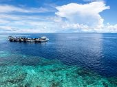 picture of sky diving  - Boats at dive site off of the coast of world famous Sipadan Island in Sabah East Malaysia - JPG