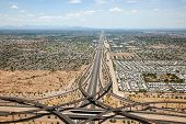 stock photo of superstition mountains  - Loop 202 Red Mountain and U.S. 60 Superstition freeway interchange in Mesa with Tempe and Phoenix Arizona in the distance.