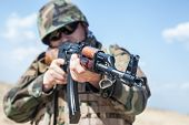 stock photo of ak 47  - russian soldier in bulletproof vest with ak-47 rifle