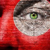 pic of superimpose  - Red face with Mayan Calendar superimposed around the eye - JPG