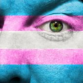 stock photo of transgendered  - Transgender Flag painted on face to show Transgender Pride support - JPG