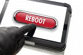 picture of reboot  - Online mobile reboot concept with hand wearing black glove pointing a touch screen - JPG