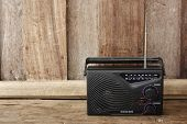 stock photo of transistor  - Close up Old transistor radio on wooden background - JPG