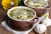 stock photo of sorrel  - Delicious green soup with sorrel on table close - JPG
