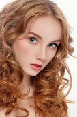 stock photo of freckle face  - Portrait of young beautiful woman with long red curly hair and fresh make - JPG
