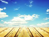 foto of puffy  - Wooden boards over a blue sky  - JPG